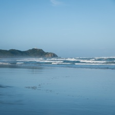 Surf mist at Tallows Beach looking north to the Byron Bay Lighthouse, Arakwal National Park